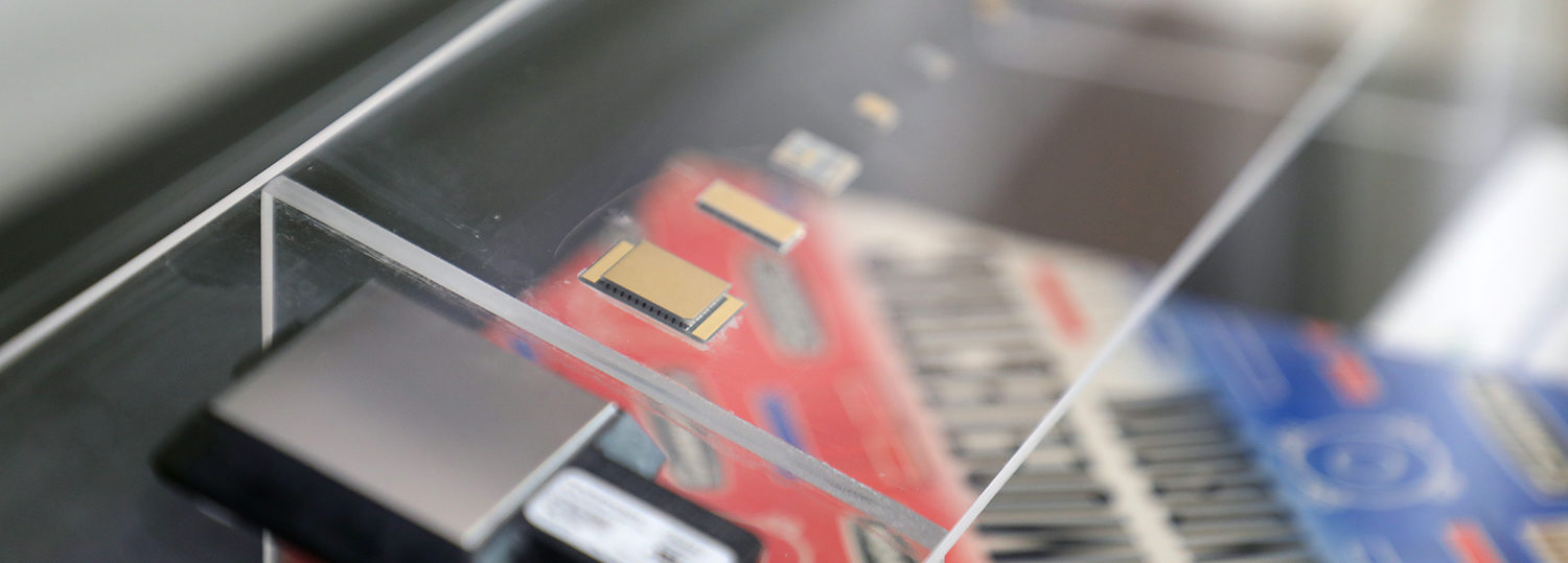 Progressively smaller chips displayed in Phononic's headquarters.